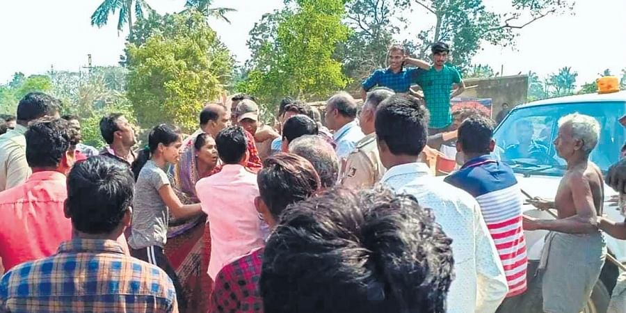 Villagers gherao police personel at Sailo in Jagatsinghpur on Thursday.