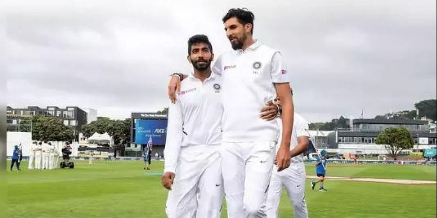India's Ishant Sharma (R) with teammate Jasprit Bumrah walk from the field after the national anthems during day one of the first Test cricket match between New Zealand and India at the Basin Reserve in Wellington