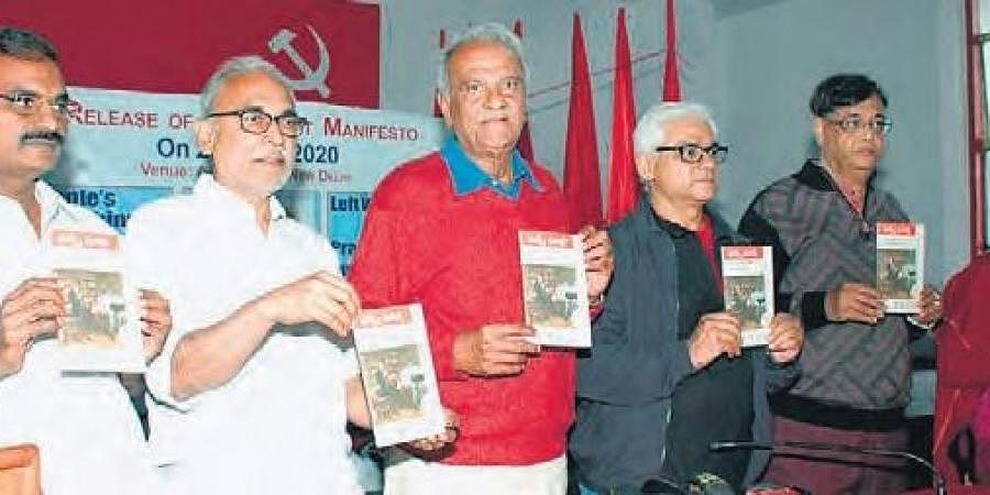 Left party leaders K Narayana and B Raghavulu at the Red Book Day programme  organised at the CPI office in New Delhi on Friday