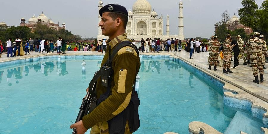 Security Forces patrol the premises of Taj Mahal ahead of US President Donald Trump s maiden visit to India in Agra Sunday