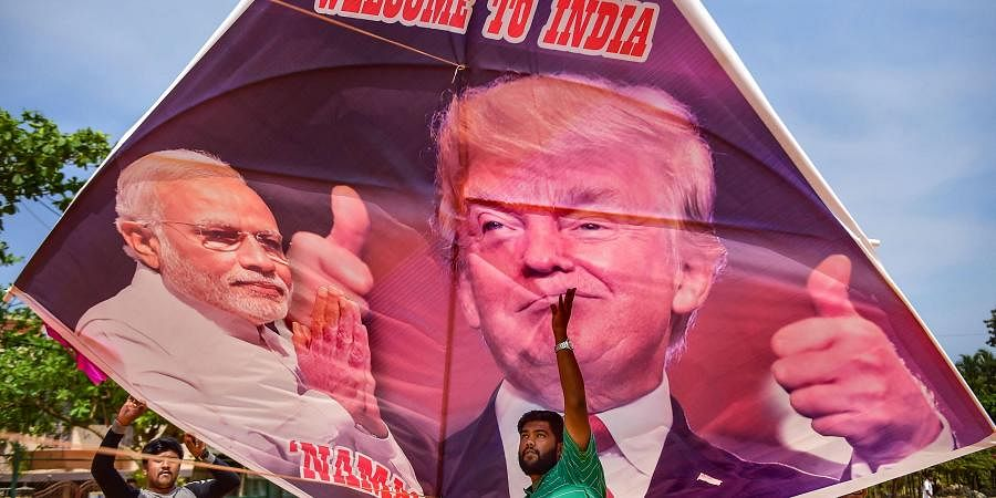 Youngster fly a kite with portraits of Prime Minister Narendra Modi and US President Donald Trump ahead of Trump's maiden visit to India in Bengaluru Sunday