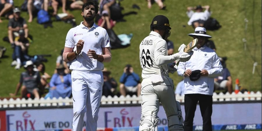 Ishant Sharma watches on as New Zealand's Tom Blundell runs through for New Zealand to defeat India by ten wickets at the Basin Reserve in Wellington