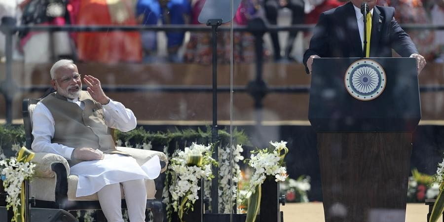 US President Donald Trump speaks, with Prime Minister Narendra Modi seated at Sardar Patel Stadium in Ahmedabad. (Photo| AP)