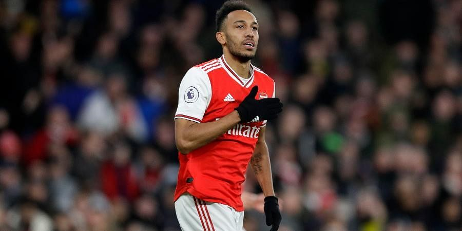 Arsenal's Pierre-Emerick Aubameyang celebrates after scoring his side's third goal during the English Premier League soccer match between Arsenal and Everton at Emirates stadium in London.
