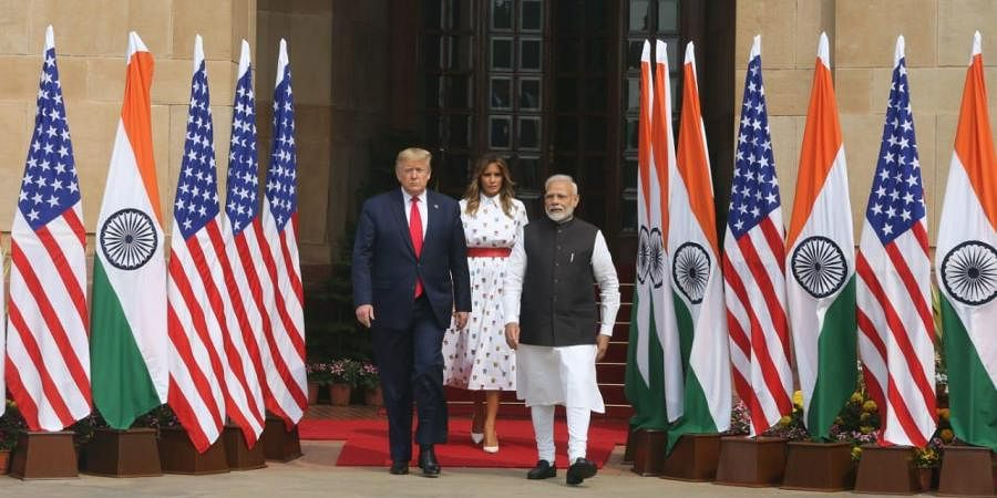 PM Narendra Modi with US President Donald Trump as first lady Melania Trump looks on at Hyderabad house in New Delhi on Tuesday