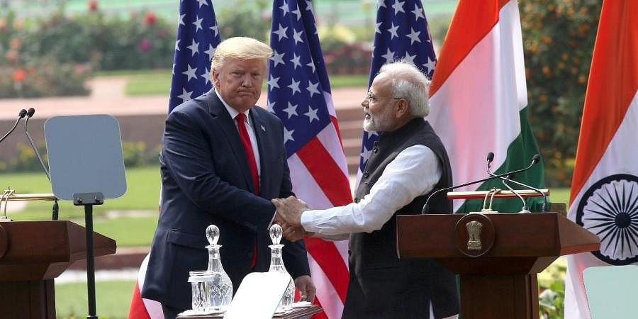 Prime Minister Narendra Modi and US President Donald Trump exchange greetings after their joint press statement