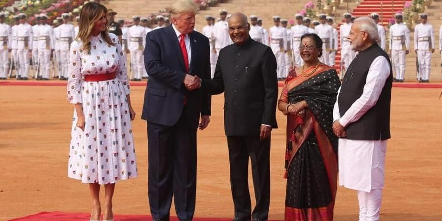 President Ram Nath Kovind shakes hands with US President Donald Trump during the latter's ceremonial welcome at Rashtrapati Bhavan in New Delhi