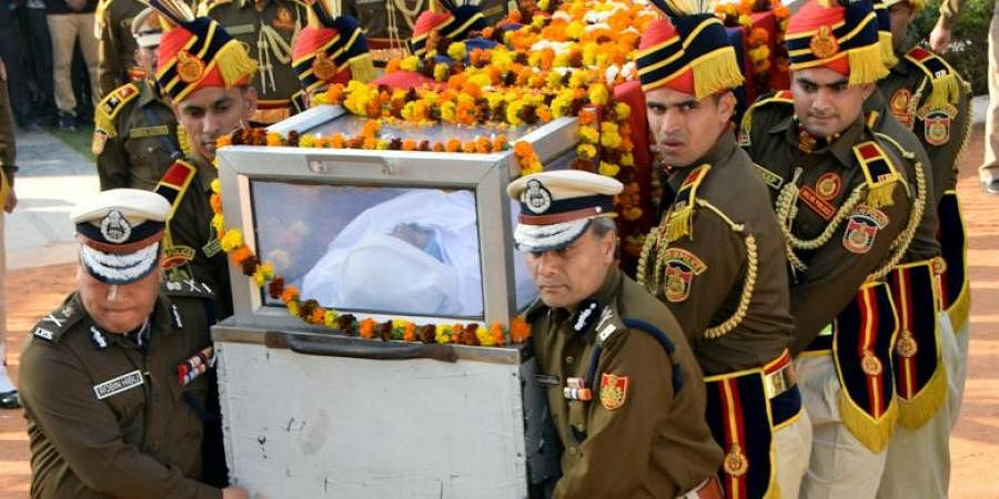 Delhi Police chief Amulya Patnaik and senior police officials carry the mortal remains of Head Constable Rattan Lal for the funeral in New Delhi on Tuesday