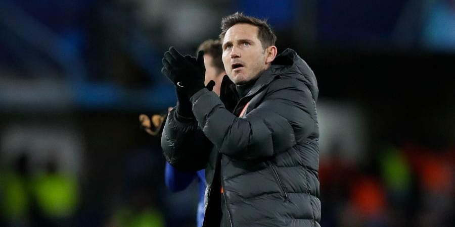 Chelsea's head coach Frank Lampard applauds fans at the end of the first leg, round of 16, Champions League soccer match between Chelsea and Bayern Munich at Stamford Bridge stadium in London.