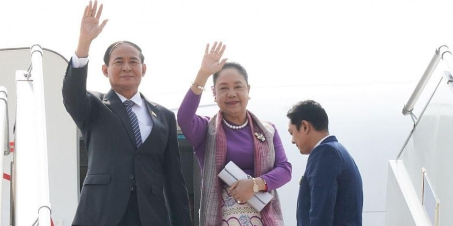 Myanmar President U Win Myint and first lady Daw Cho Cho arrive in India