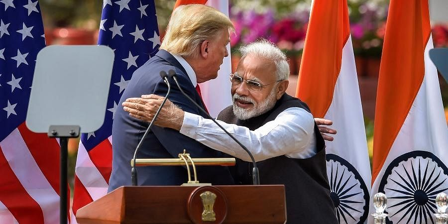 PM Narendra Modi (R) and US President Donald Trump exchange greetings after their joint press statement at the Hyderabad House in New Delhi