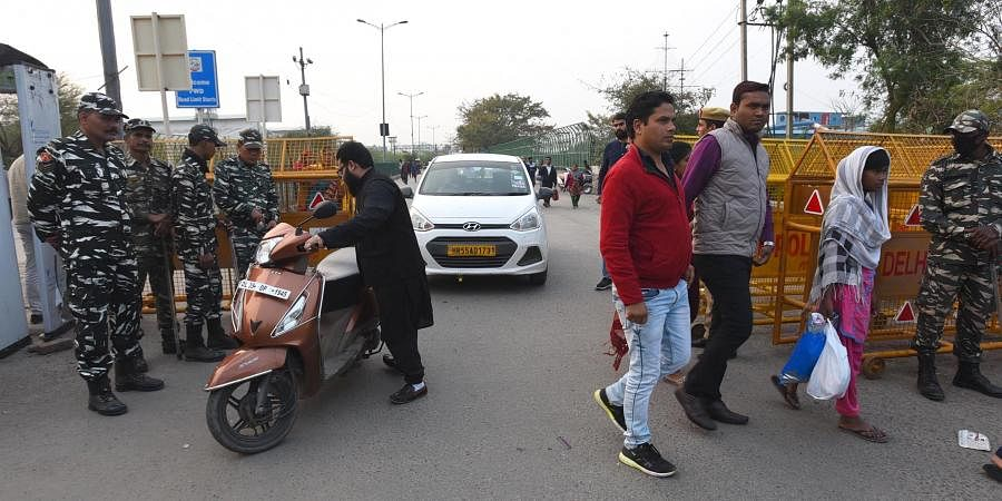 Police remove barricade in Shaheen Bagh for opening traffic from Kalindi Kunj Road to Noida in New Delhi