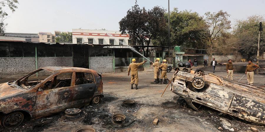 Firemen try to control blaze at tyre market at Gokulpuri in northeast Delhi on Wednesday.