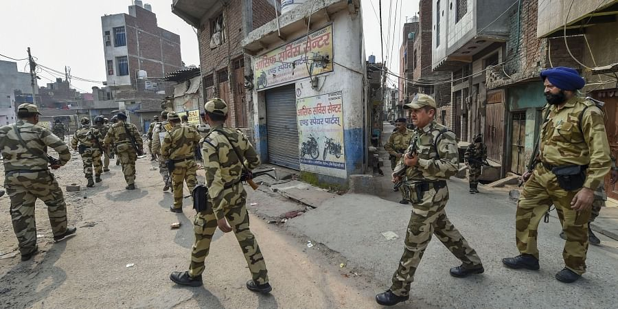 Security personnel patrol streets following clashes over the new citizenship law, in Bhagirathi area of northeast Delhi.