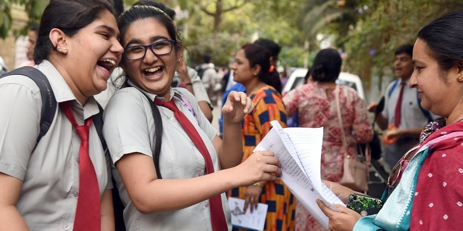 CBSE candidates share a light moment with their parents after writing the English board exam in Bengaluru