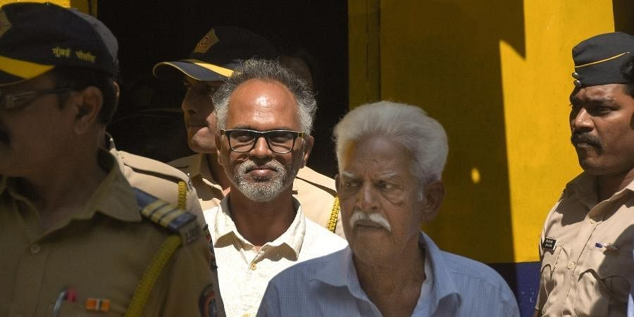 P Varavara Rao and Sudhir Dhawale, who are accused in the Elgar Parishad case, are escorted by police to court