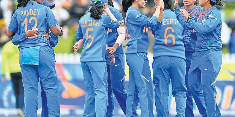 India players celebrate after securing a nail-biting victory over New Zealand at the Junction Oval in Melbourne on Thursday. They next face Sri Lanka on Saturday.