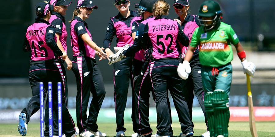 New Zealand player celebrate after running out Bangladesh batswoman Fargana Hoque Pinky (R) during their Twenty20 women's World Cup cricket match in Melbourne on February 29, 2020.