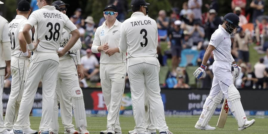 India's Virat Kohli walks from the field after he was dismissed by New Zealand's Tim Southee, left, for three runs. (Photo | AP)