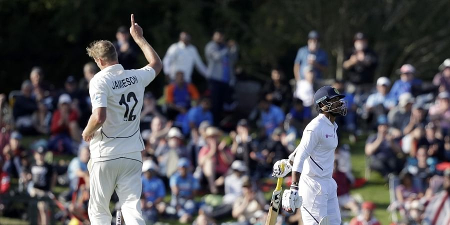 New Zealand's Kyle Jamieson, left, celebrates after dismissing India's Umesh Yadav, right, for no score during play on day one. (Photo | AP)