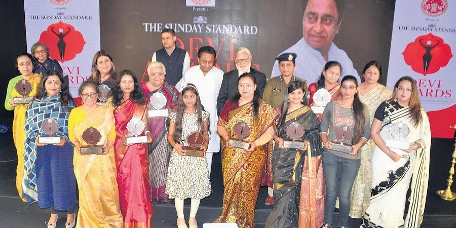 MP Chief Minister Kamal Nath and The New Indian Express Group Editorial Director Prabhu Chawla with the women honoured with Devi Awards in Indore on Friday.