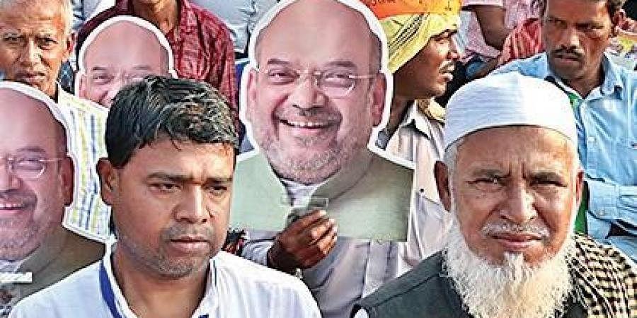 Supporters of BJP carrying masks of Home Minister Amit Shah at Janata Maidan
