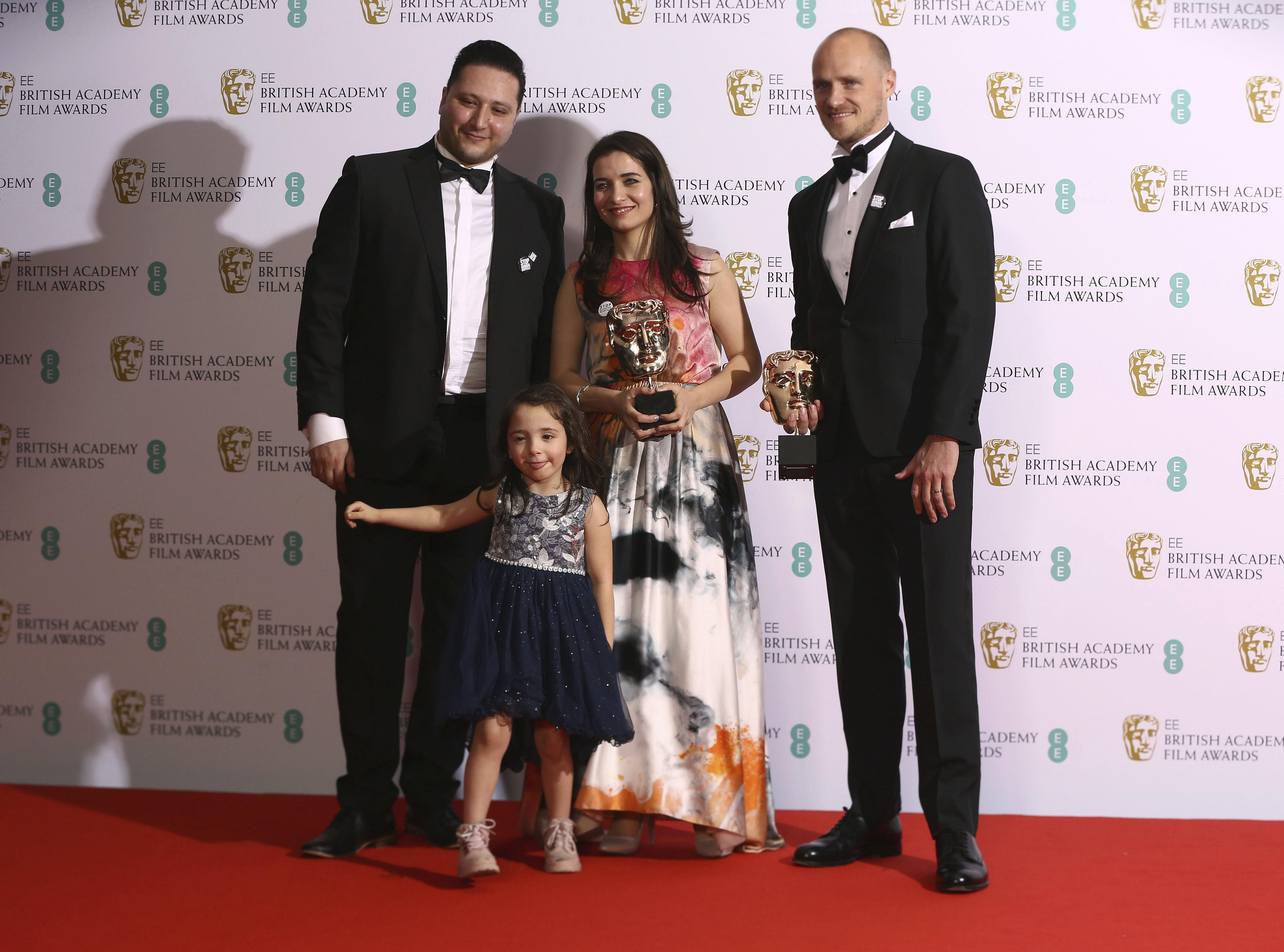 Hamza al-Kateab, Waad Al-Kateab and Edward Watts, winner of the 'Best Documentary' award for 'For Sama' at the BAFTA Film Awards.