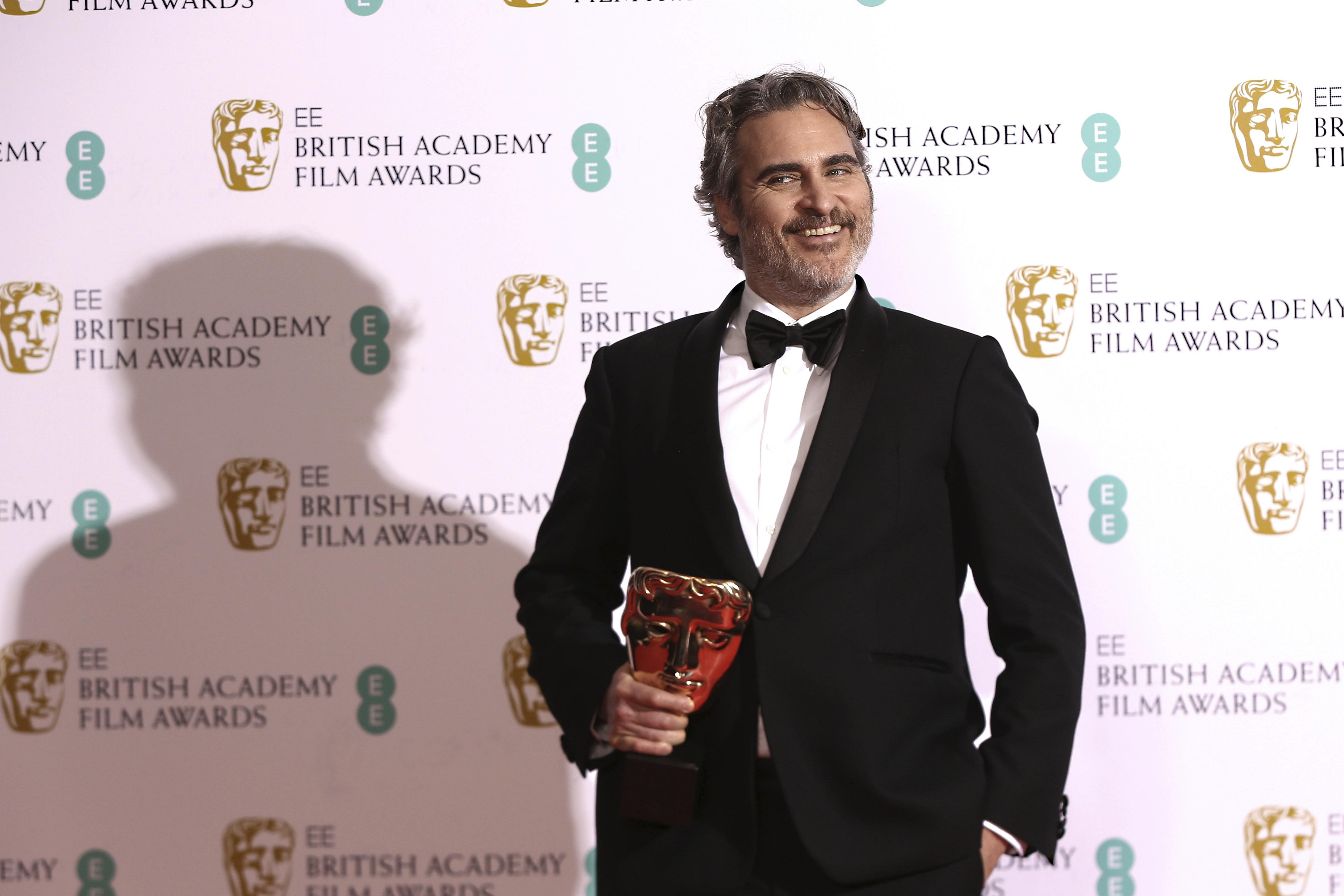 Actor Joaquin Phoenix poses with his award for 'Best Actor' for the film 'Joker' at the BAFTA Film Awards. Recently, he won the 'Best Actor' award at the SAG Awards too.