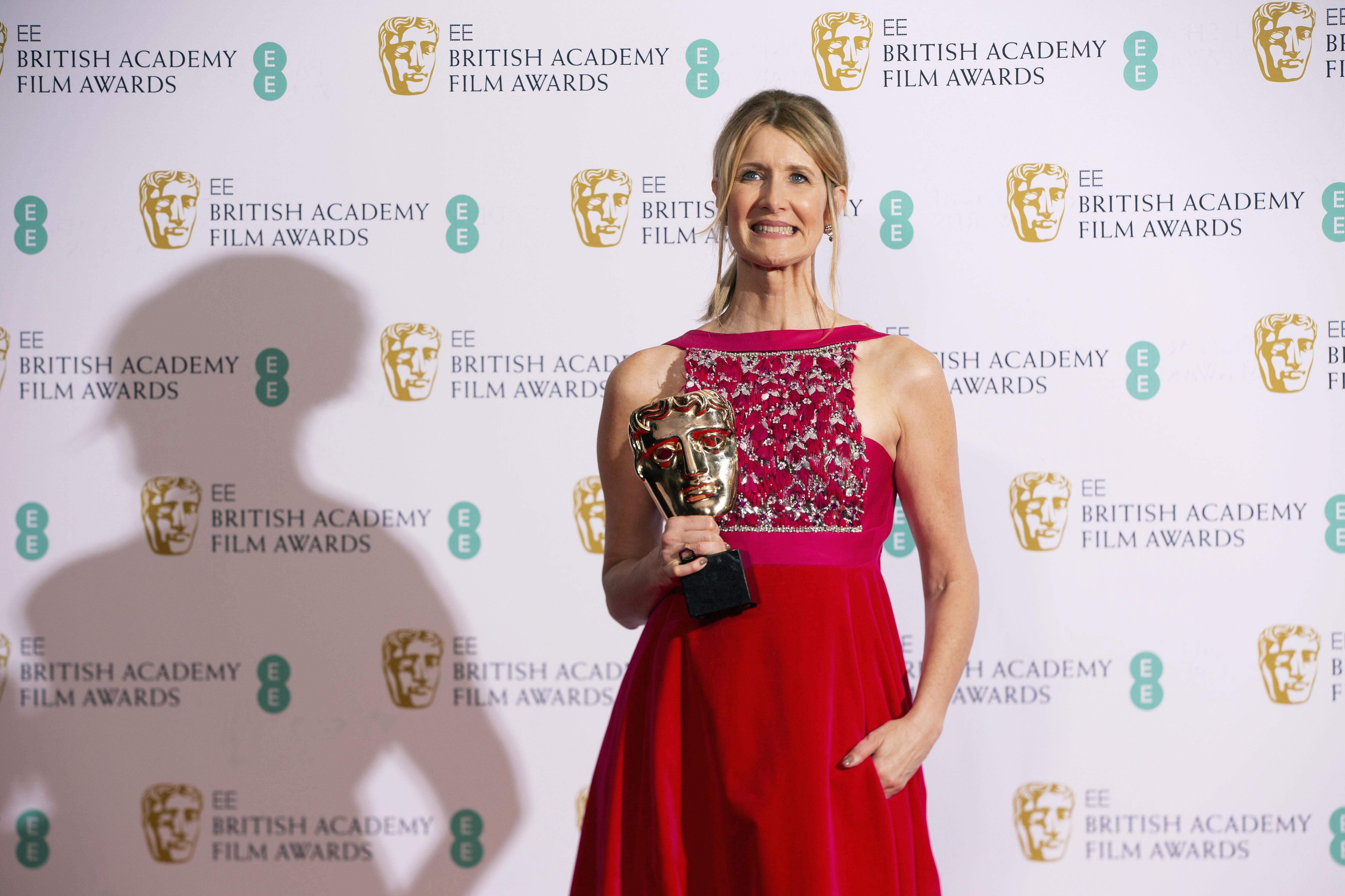 Actress Laura Dern winner of 'Best Supporting Actress' for 'Marriage Story', poses with her award backstage at the BAFTA Film Awards.