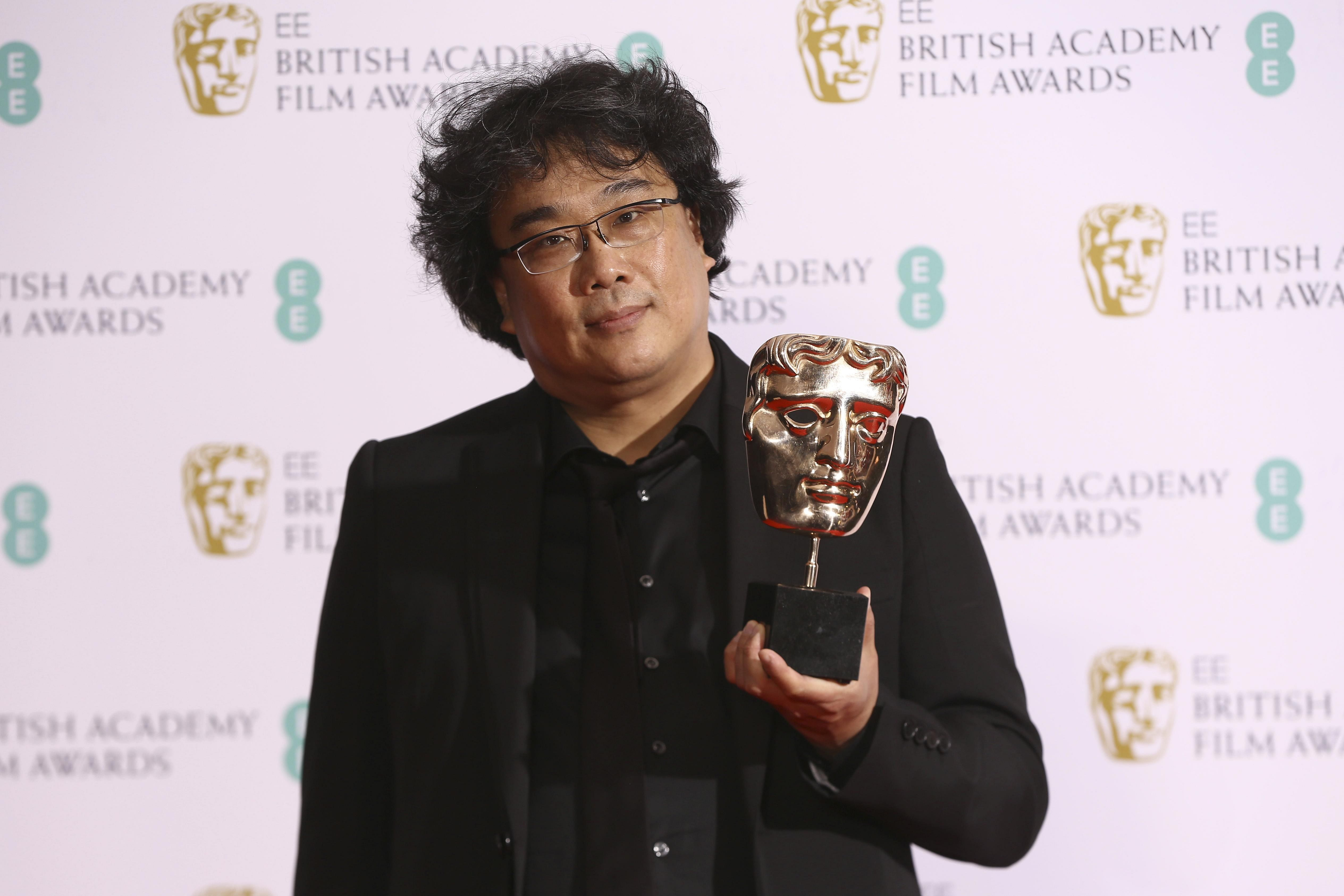 Director Bong Joon-ho holds the 'Best Foreign Language' BAFTA Award for the film 'Parasite'. The film also won 'Best motion picture cast' award at the SAG Awards and was named 'Film of the year' by London Film Critics Circle.
