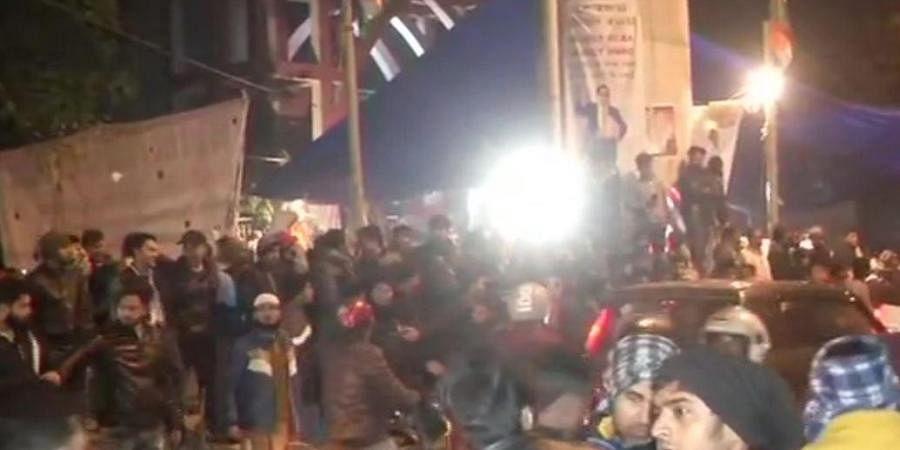 Crowd gathers outside Jamia Millia Islamia University. (Photo   ANI)