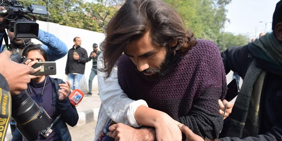Shadab Farooq, student of the Jamia Millia Islamia university injured after a minor allegedly opened firing during an anti-CAA protest is assisted towards a hospital in New Delhi Thursday Jan. 30 2020.