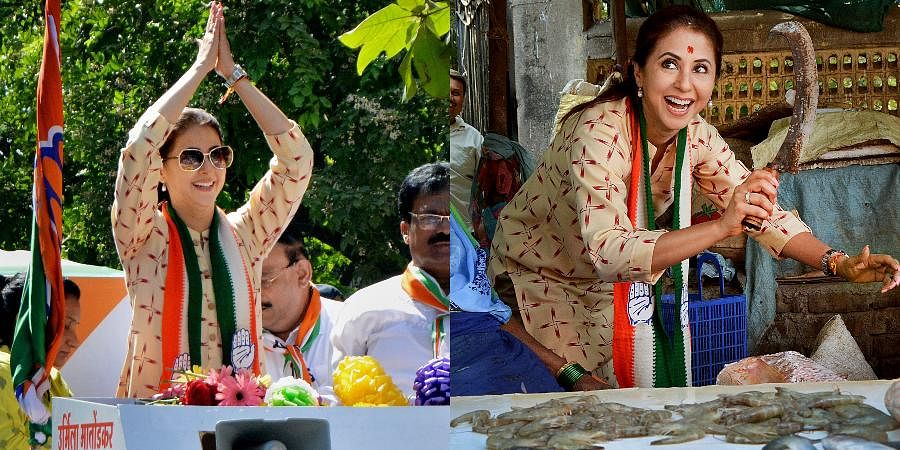Bollywood actress and Congress' Mumbai North candidate Urmila Matondkar interacts with people as she campaigns for Lok Sabha polls at Borivali West in Mumbai.