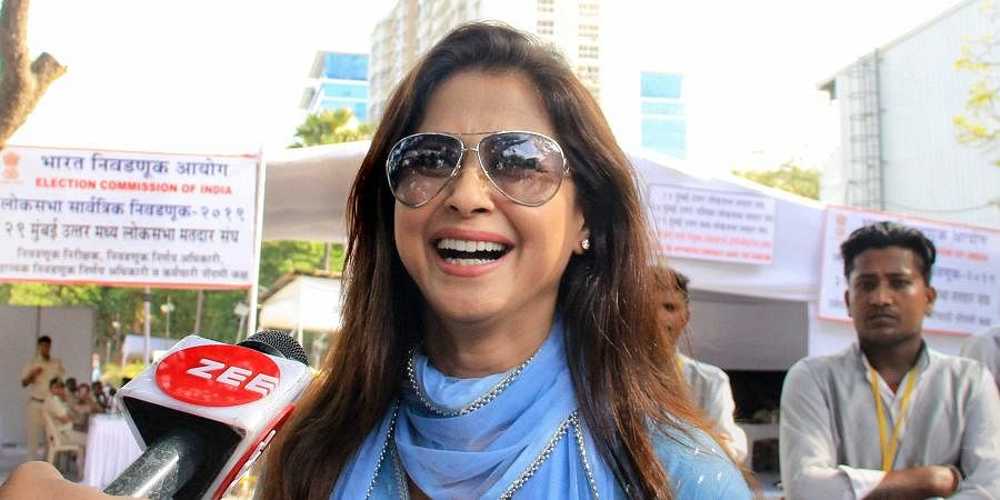 Bollywood actress and Congress' Mumbai North candidate Urmila Matondkar interacts with the media as she arrives at a counting centre for the Lok Sabha elections results in Mumbai.