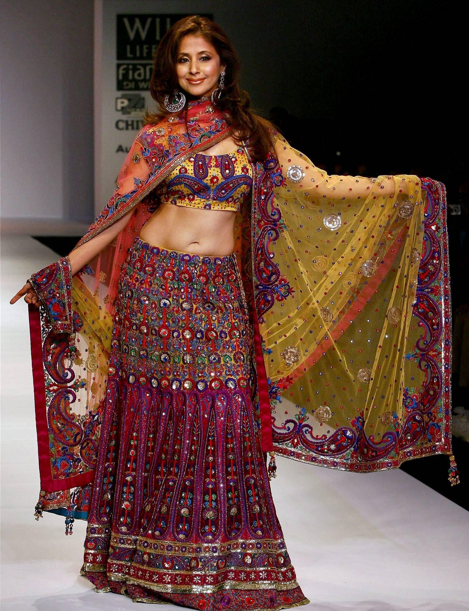 Bollywood actress Urmila Matondkar showcases creation of designer during the Wills Lifestyle India Fashion Week in New Delhi.