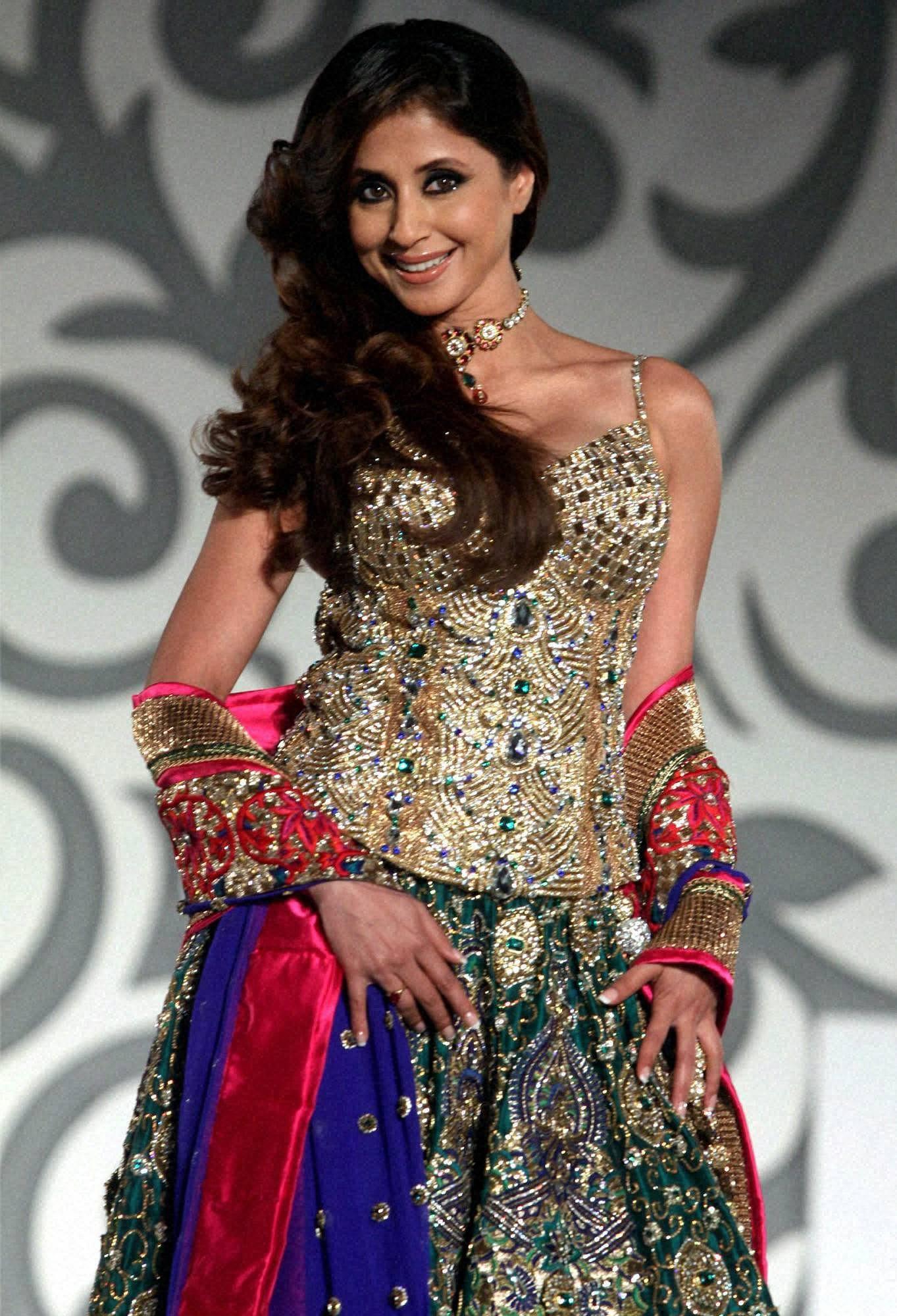 Bollywood actress Urmila Matondkar displays designer Nisha Sagar creation during the Aamby Valley India Bridal Week in Mumbai.