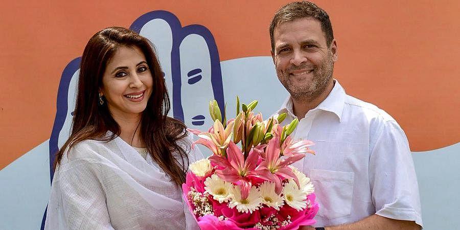 Then Congress president Rahul Gandhi greets Bollywood actress Urmila Matondkar.