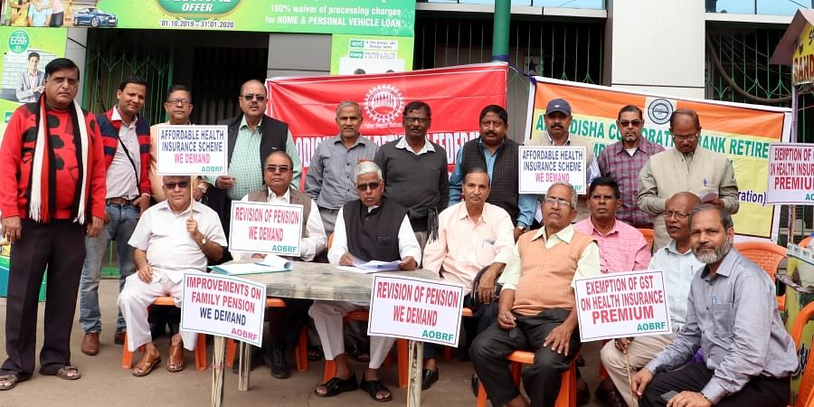Members of All Odisha Bank Retirees' Federation staging dharna in Bhubaneswar on Monday