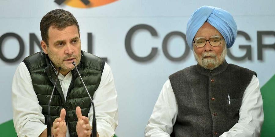 FormerPMManmohan Singh with Congress MP Rahul Gandhi