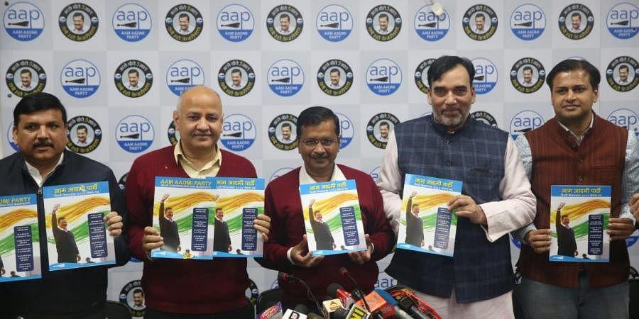 Delhi CM Arvind Kejriwal, dy CM Manish Sisodia and AAP leaders Sanjay Singh and Gopal Rai release the party manifesto in New Delhi