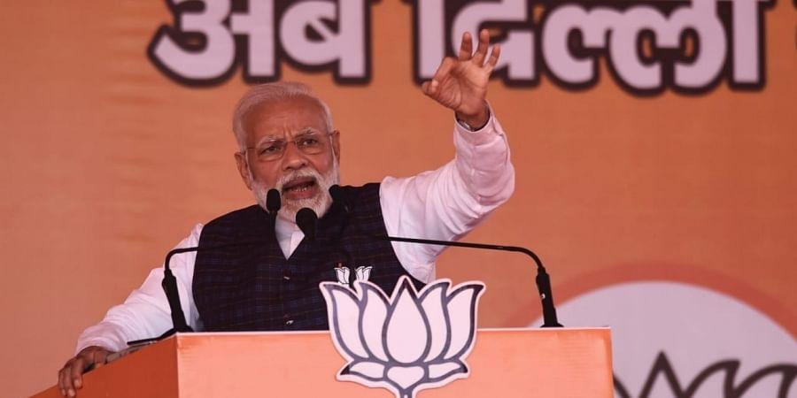 Prime Minister Narendra Modi addresses an election campaign rally at Dwarka in New Delhi