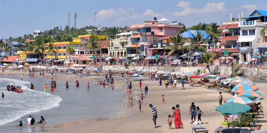 A scene from the crowded Kovalam beach with tourists braving the  scorching heat of the afternoon