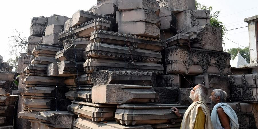 Visitors look at stone slabs carved-out for the construction of Ram Temple at Shri Ram Janmbhoomi Karyashala workshop in Karsewakpuram Ayodhya (Photo | PTI)