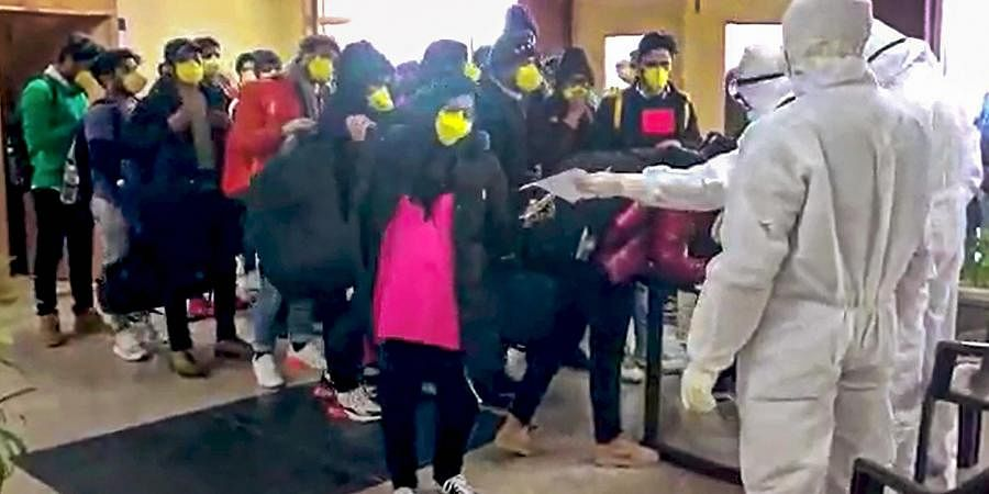 Indian nationals after they were brought by an Air India aircraft from China's coronavirus-hit city of Wuhan stand in a queue at a quarantine facility set up by ITBP at Chhawla area in New Delhi Sunday Feb. 2 2020.  (Photo | Youtube Screengrab)