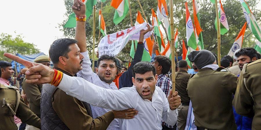 Protestors raise slogans during a pro-CAA demonstration outside Jamia University in New Delhi Tuesday Feb. 4 2020. (Photo | PTI)