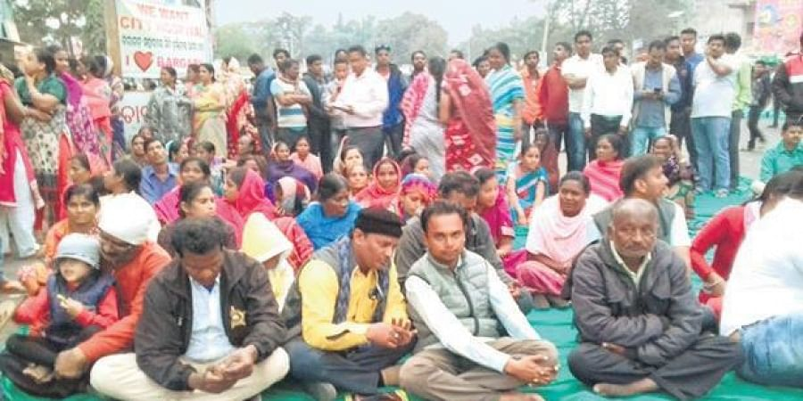 People staging a blockade at Bhatli Road chowk in Bargarh on Tuesday.