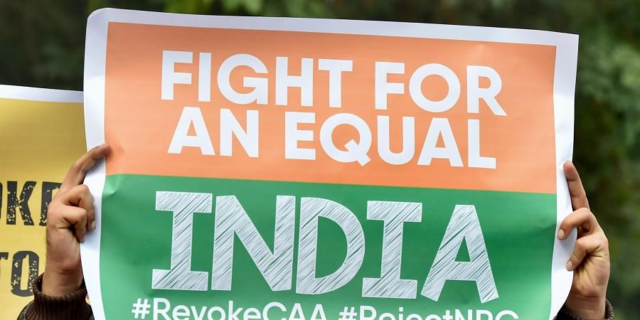 Activists hold placards during anti-Citizenship Act protest. (Photo| PTI)