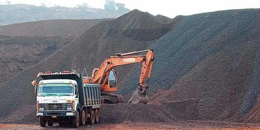A lorry and an earth-mover at a mining site.