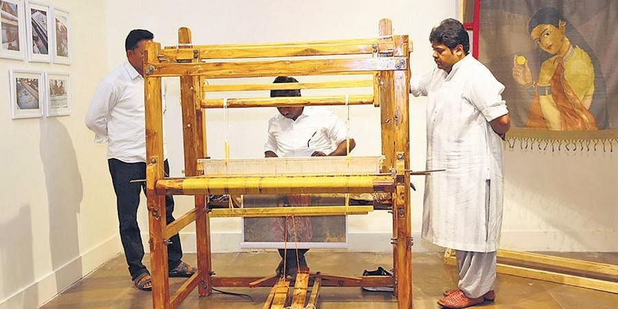 Gaurang Shah with a weaver(left, Lavina Baldota against Jean-Francois Lesage installation