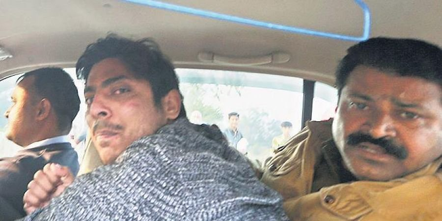 Police take away Kapil Gujjar of Dallupura, who opened fire at Shaheen Bagh area of New Delhi on Saturday.